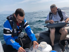 Research divers on a boat
